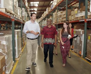MRC Director visiting Direct Relief warehouse